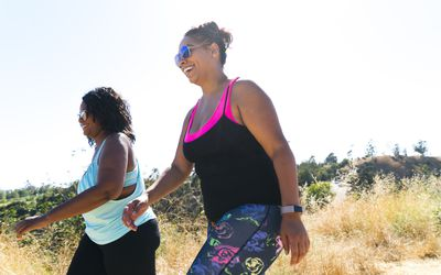 Two women going for a walk together.