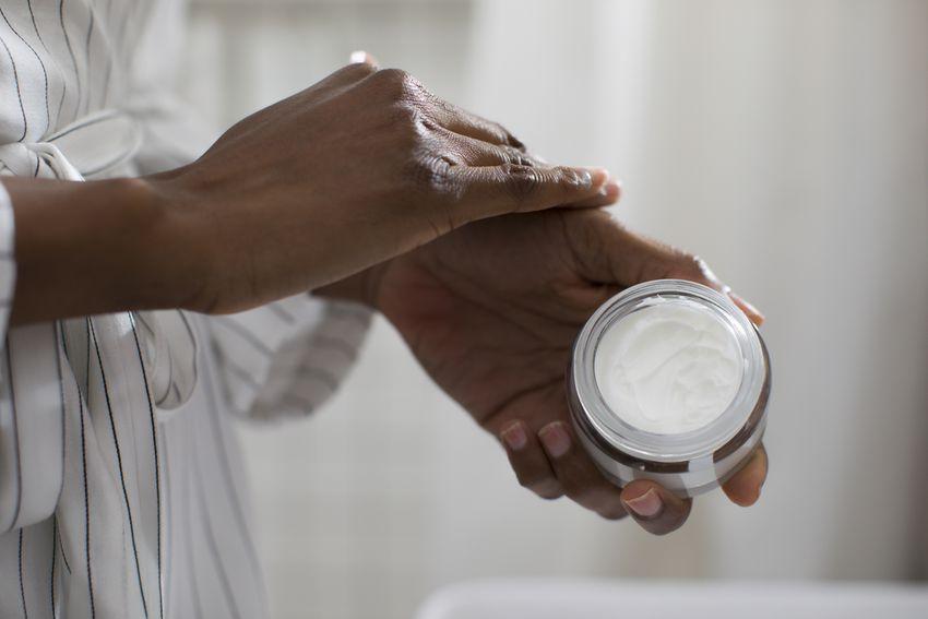 Hands of Unrecognisable Woman Holding Cosmetic Cream