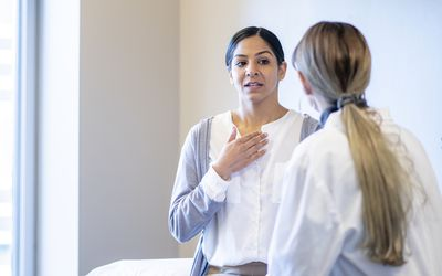 woman talking to doctor about breath