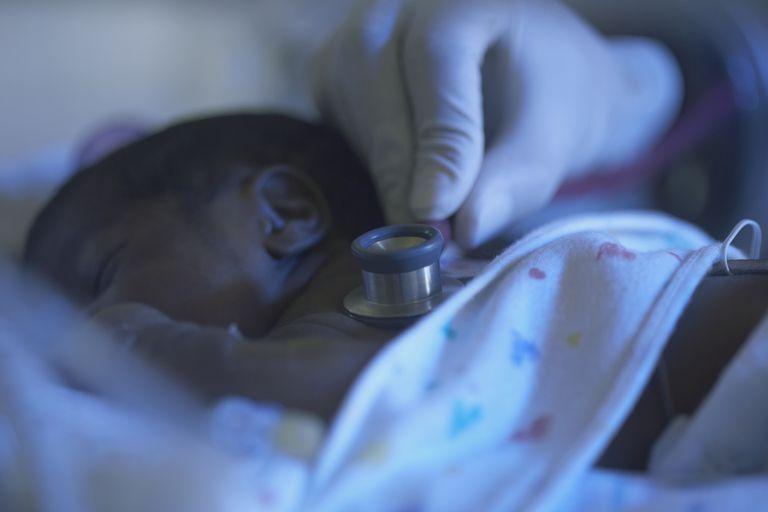 newborn being examined