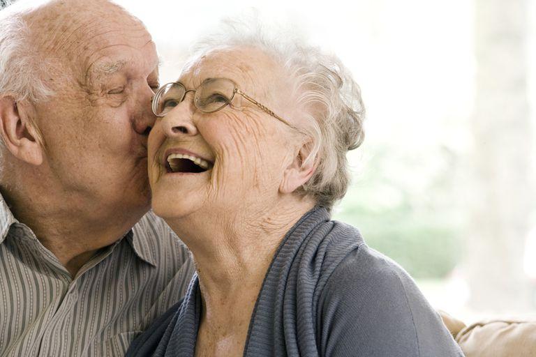 A senior couple living in a nursing home.