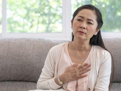 Portrait of elderly woman having heart attack