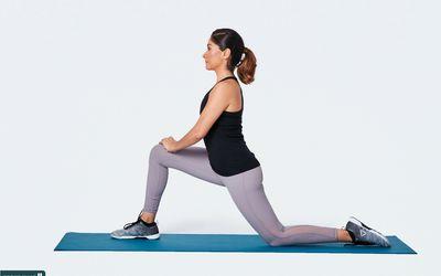 woman doing kneeling hip flexor stretch