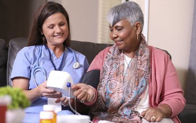 Lisinopril can treat high blood pressure or heart failure. Nurse with patient.