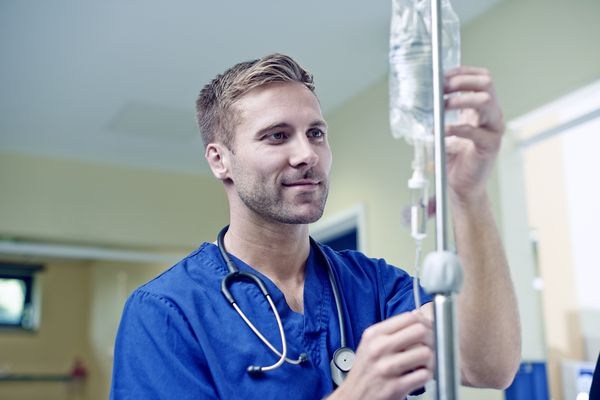Male nurse with IV bag.