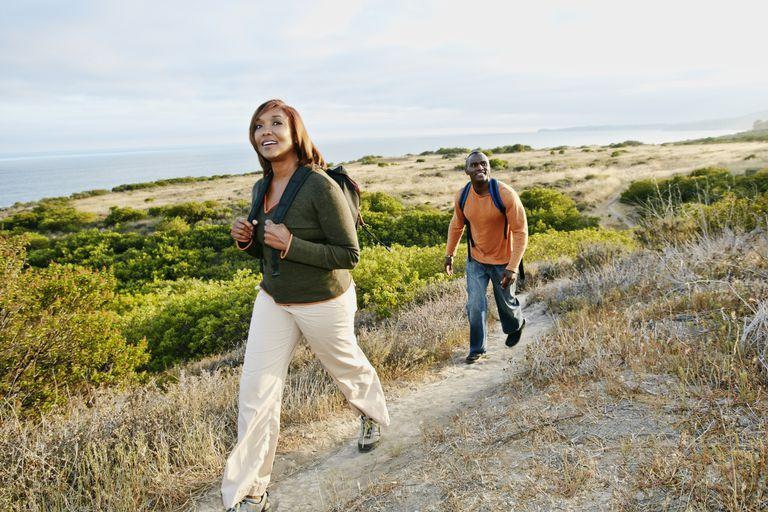 Black couple hiking on rural path