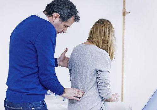 Doctor Examining Patients back