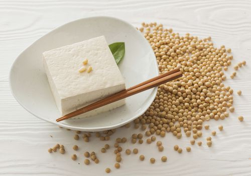 Soy Beans scattered around a plate of tofu