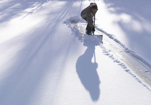 A man shoveling snow outside