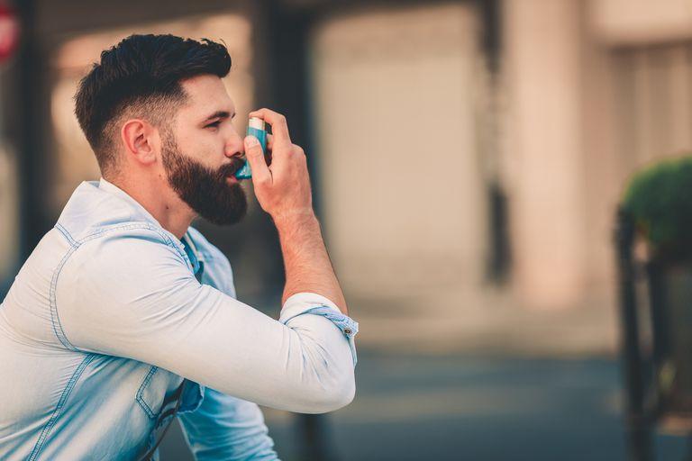 Man using inhaler outside
