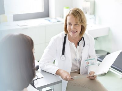 A doctor talking with her patient