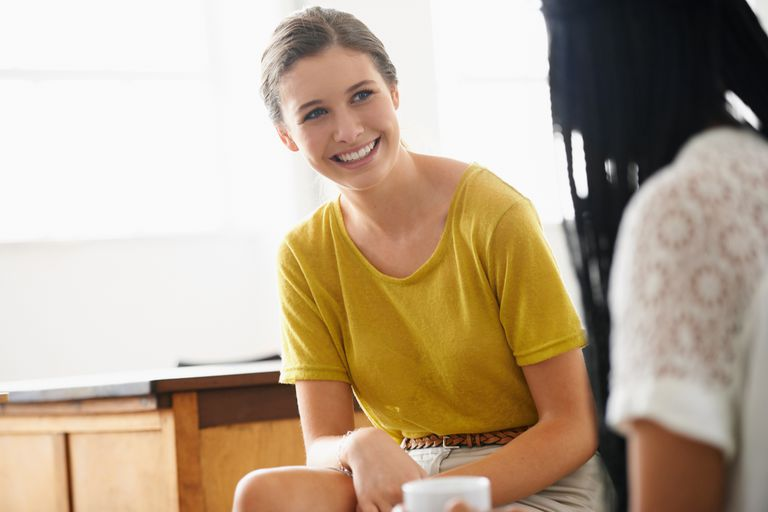 A health coach talking to her client