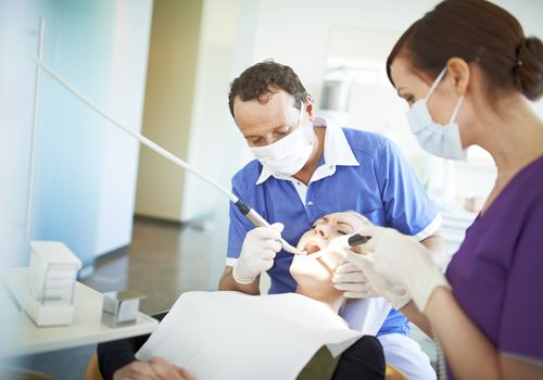 Dentist giving patient exam