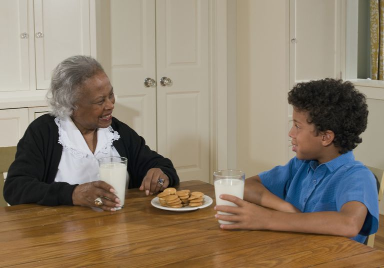 A grandmother and grandson at a table