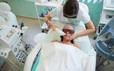 A woman having laser facial hair removal