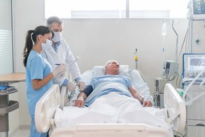 physicians checking patient's vitals in ICU