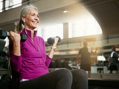 An older woman working out at the gym