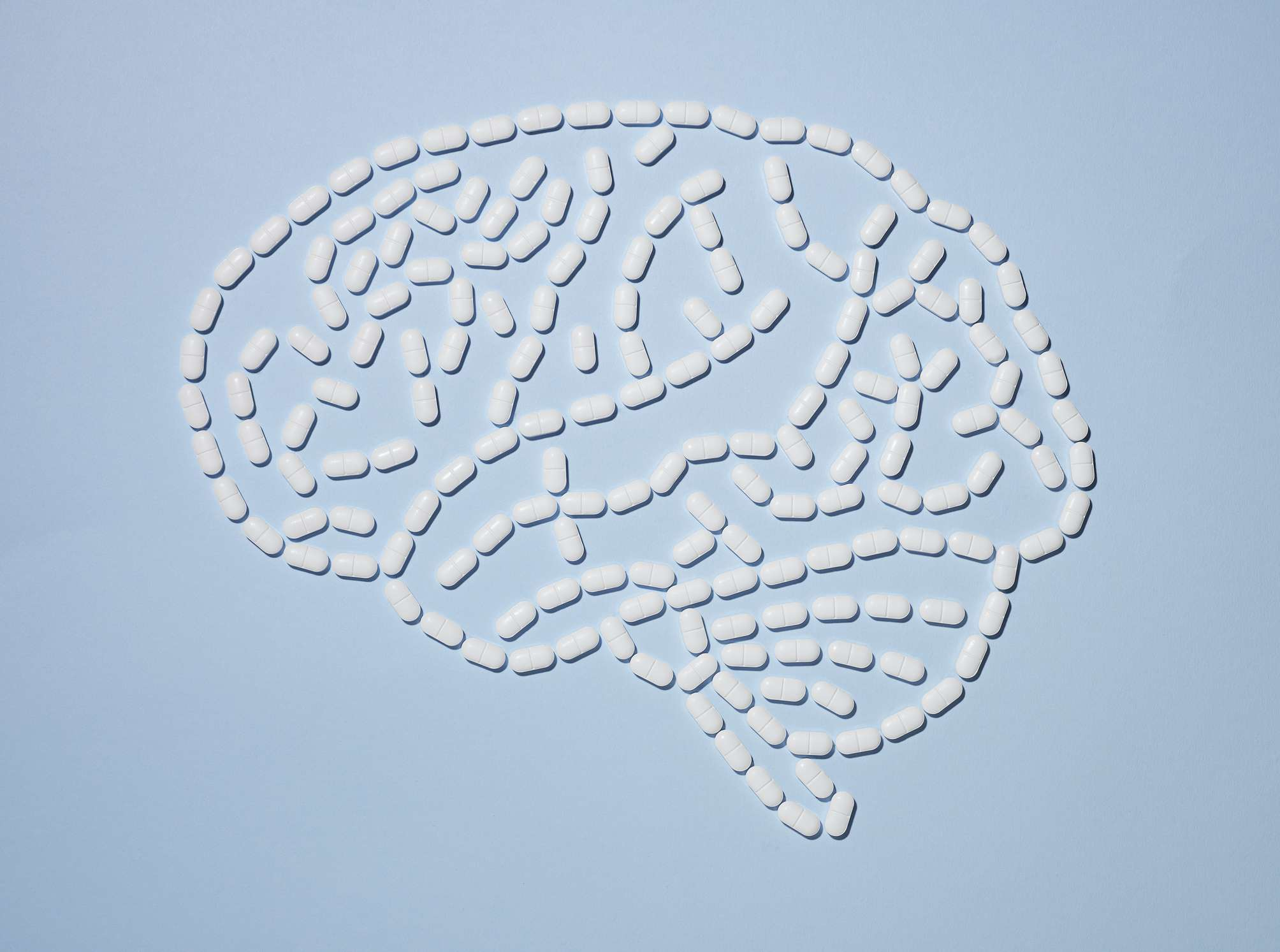 White pills laid out in the shape of a brain
