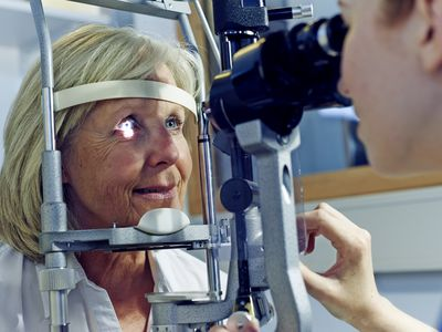 An ophthalmologist performs an eye exam