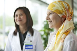 Mature woman standing with doctor at hospital