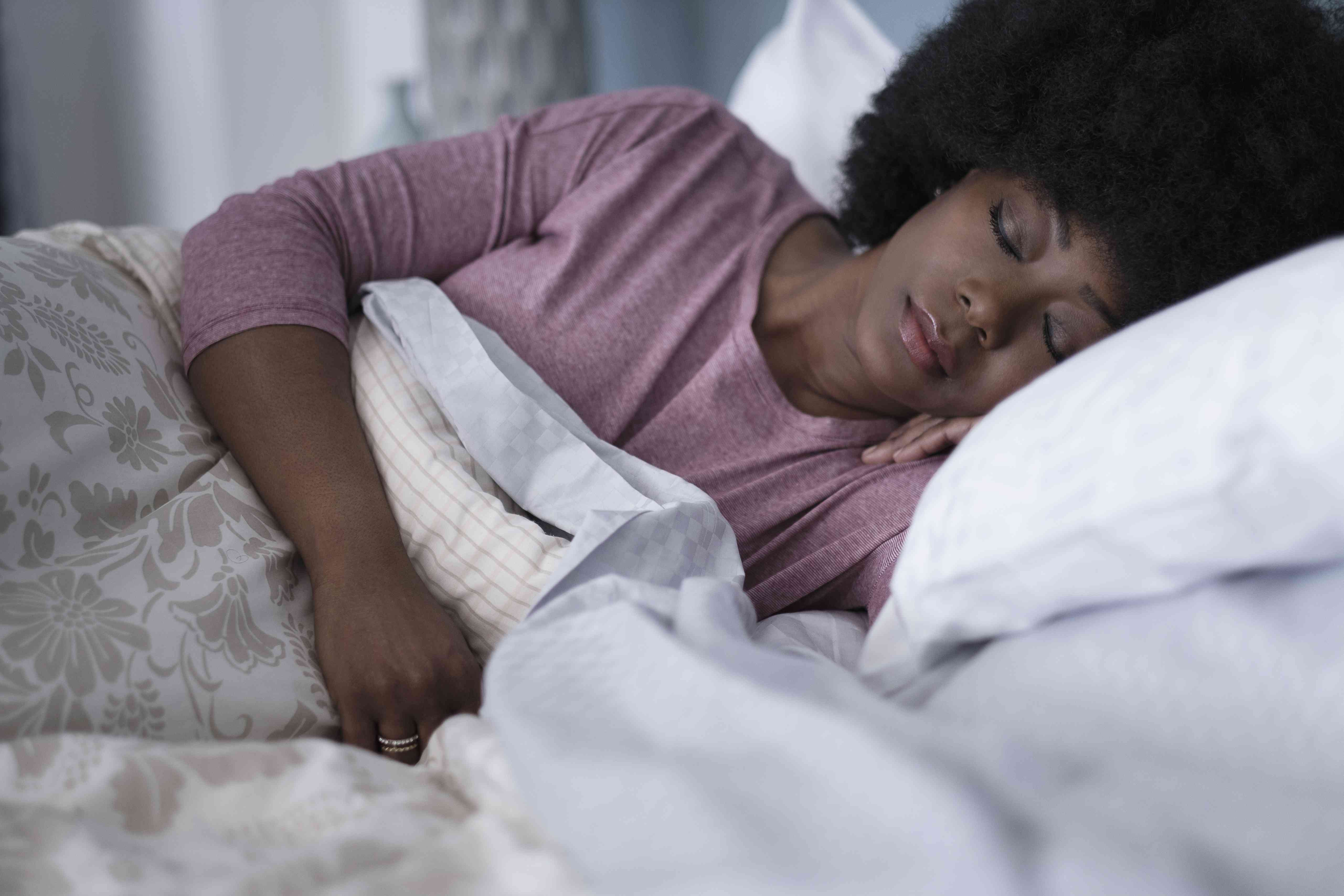 Mature woman sleeping in bedroom