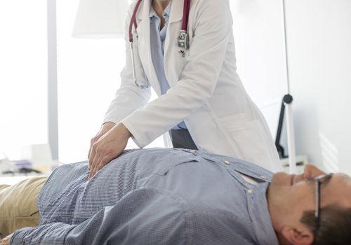 Doctor examining a man.