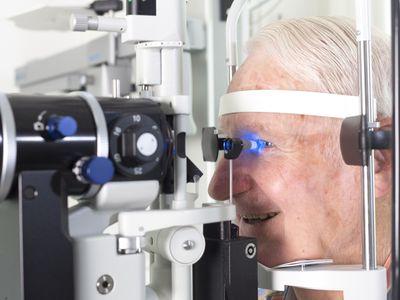 An older man receiving an eye exam