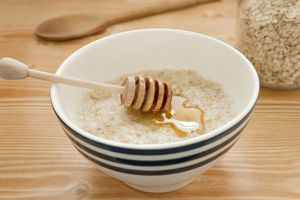 bowl of oatmeal with honey