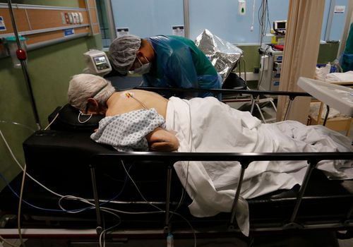 hospitalized patient on ventilator in prone position