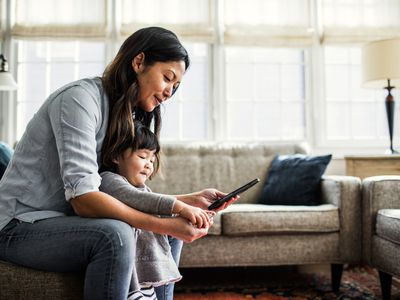 Woman and Daughter Using a Cell Phone