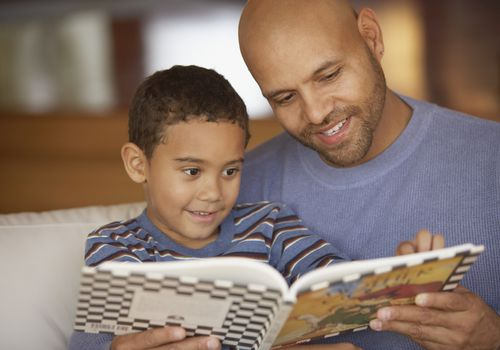 father reads with son