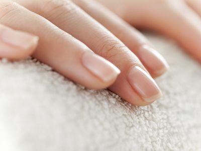closeup of a woman's fingernails and fingers