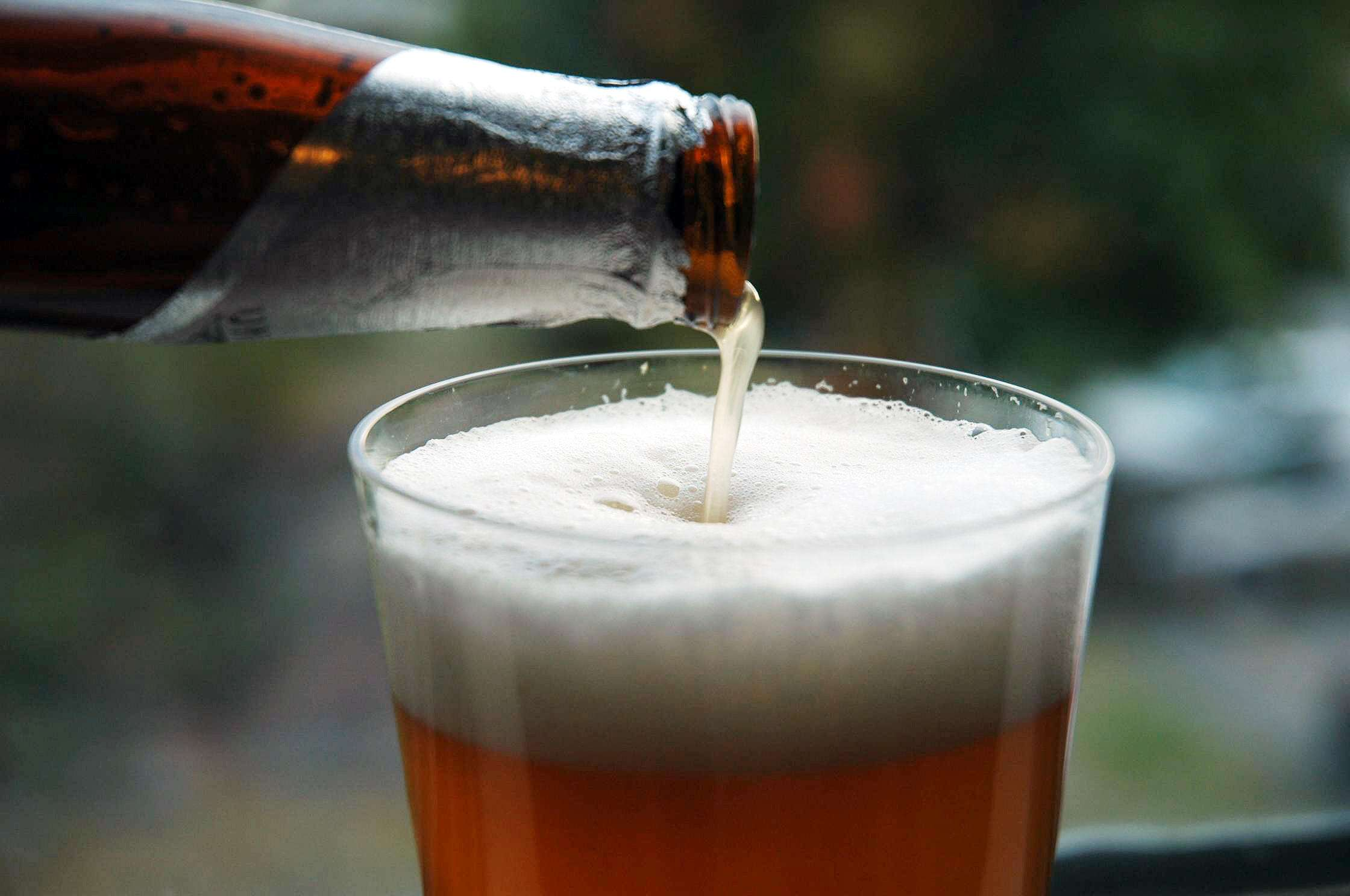 A beer being poured into a chilled glass