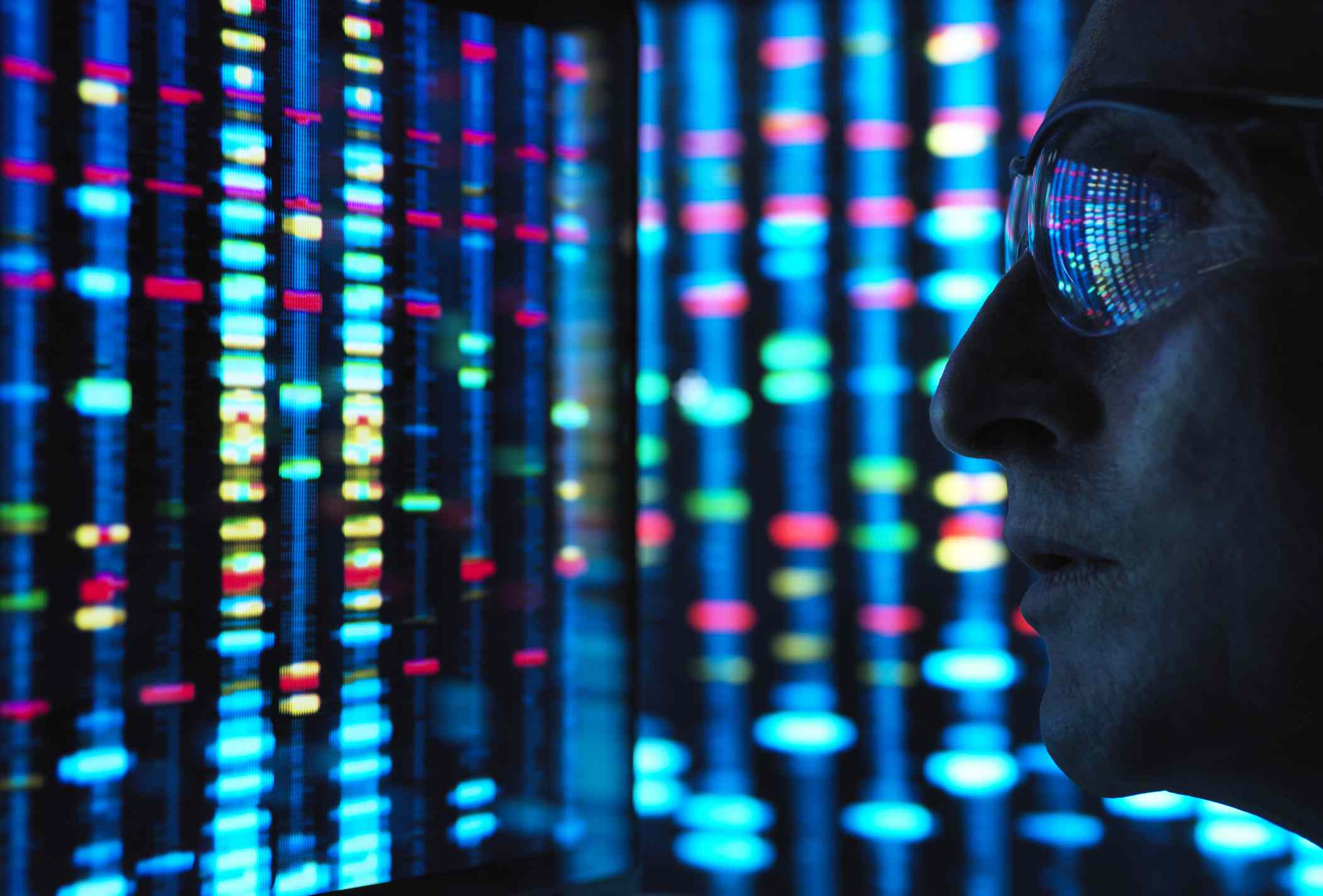 Genetic Research, scientist viewing DNA information on screens - stock photo