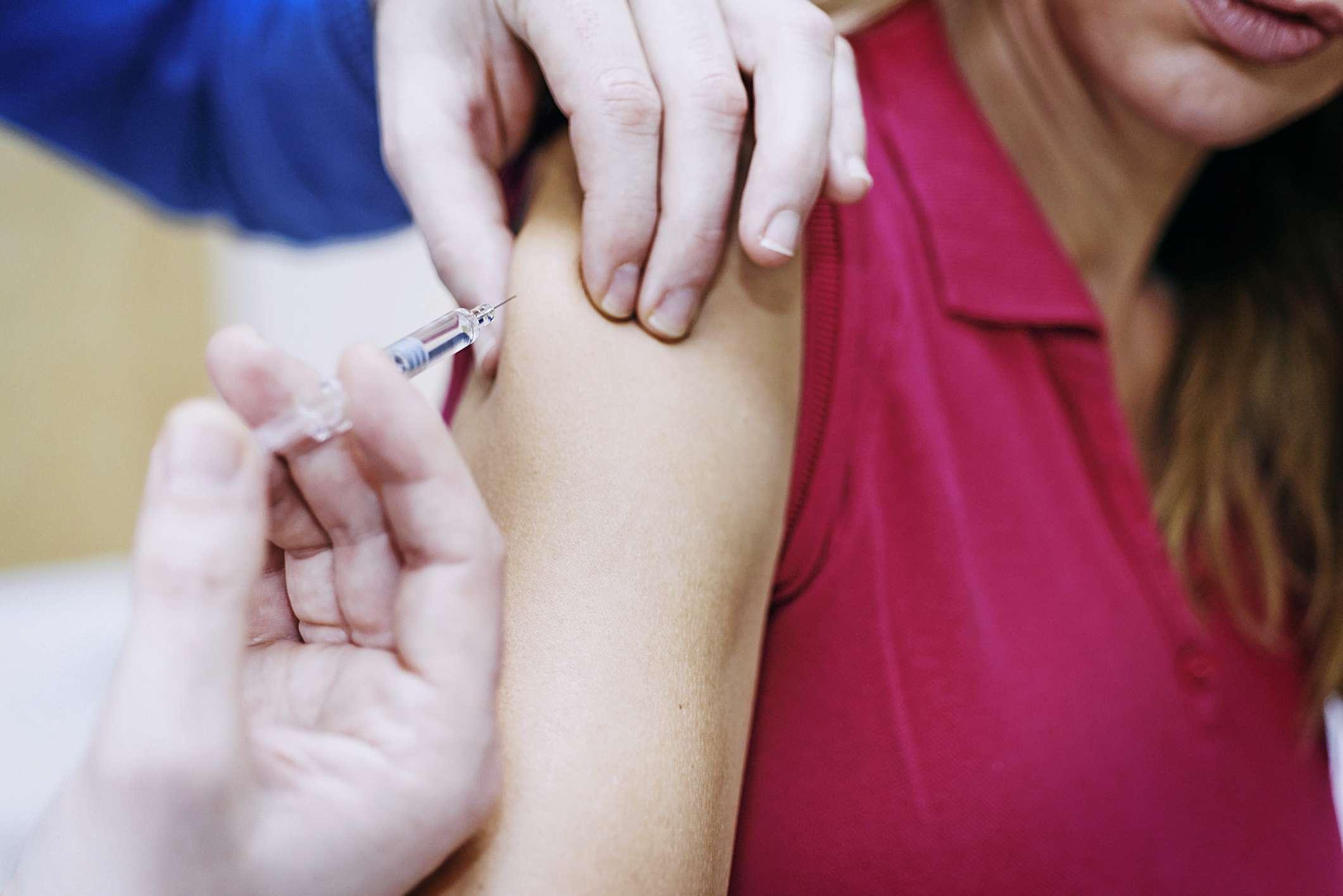 Girl receiving vaccine