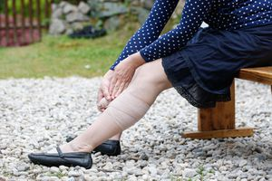 Woman wrapping her lower leg