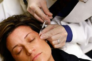 woman getting facial injection