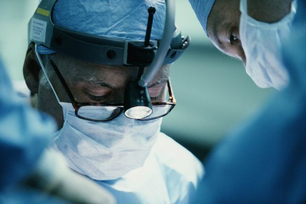 Surgeons performing prostate surgery, close-up
