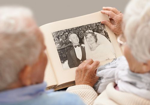 Older couple looking at photo album