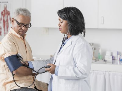 Man getting blood pressure checked by his doctor
