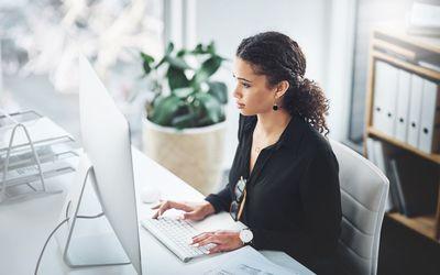 Woman using computer at work