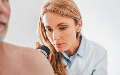 dermatologist examining skin