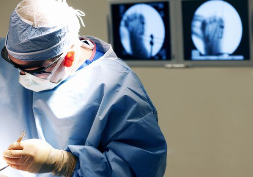 doctor performing fracture surgery