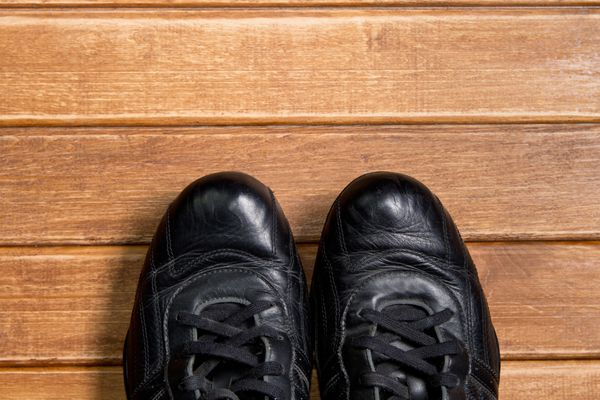 Athletic shoes on wooden background.