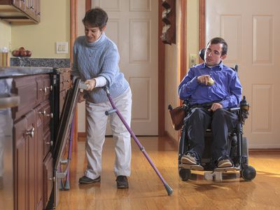 A couple with cerebral palsy in the kitchen