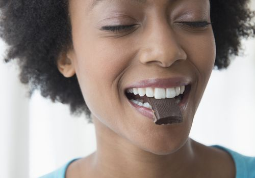 Woman joyfully Eating chocolate
