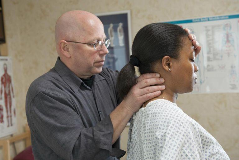 Chiropractor helping patient