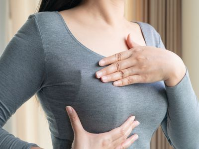 Midsection Of Woman Touching Chest