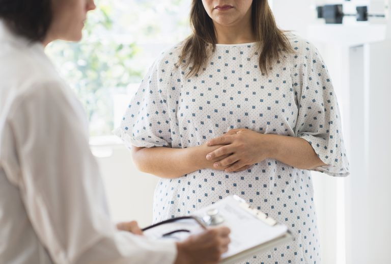 Woman visiting with doctor