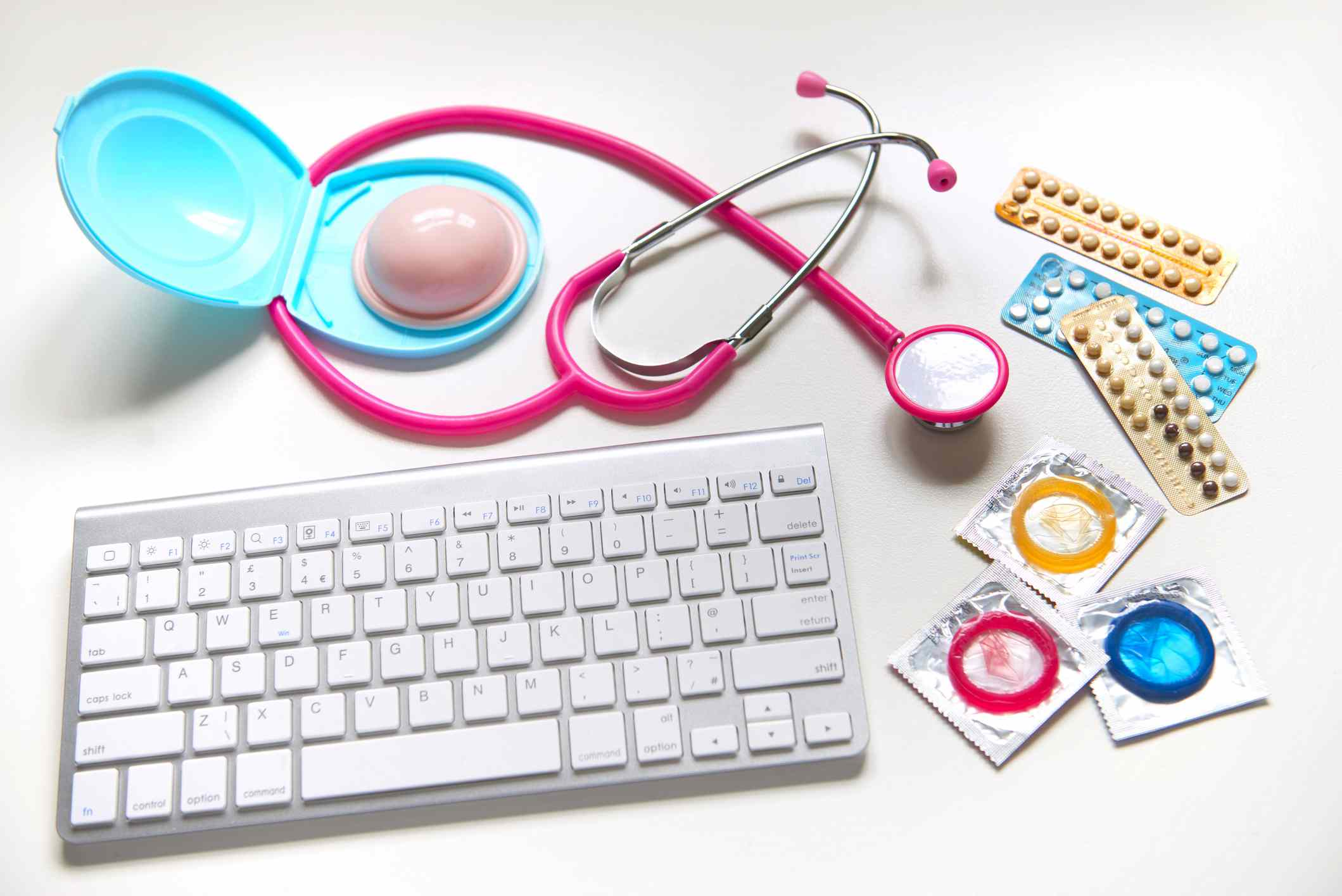 Various forms of birth control, a stethoscope, and a keyboard